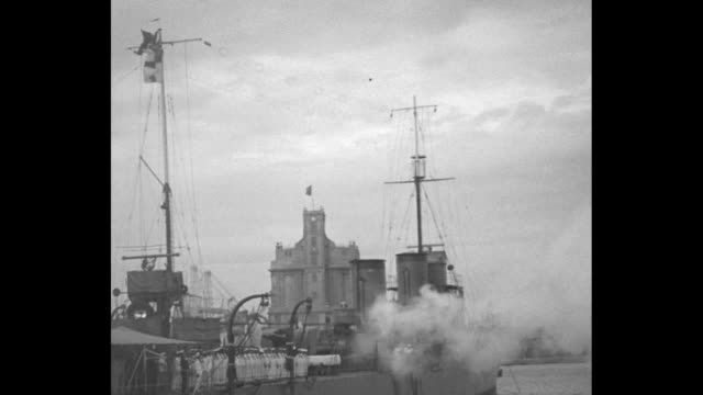 sir austen chamberlain's royal yacht giuliana in harbor, italian navy flag in fg / various shots destroyer firing salute, launch with benito... - benito mussolini stock videos & royalty-free footage