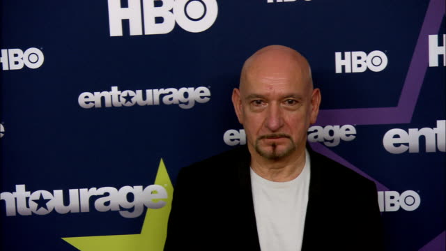 Sir Ben Kingsley posing for paparazzi as he moves along the red carpet at the Beacon Theater