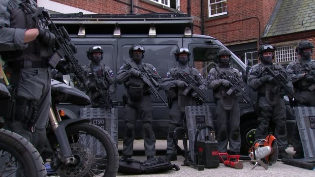 sir bernard hoganhowe annouces his retirement lib / tx ext various of photocall of elite armed police officers wearing body armour balaclavas and... - armored vehicle stock videos & royalty-free footage