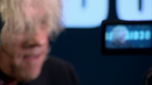 stockvideo's en b-roll-footage met sir bob geldof preparing to release a new version of do they know its christmas to coincide with 30th anniversary of band aid showing interiors of... - bob geldof