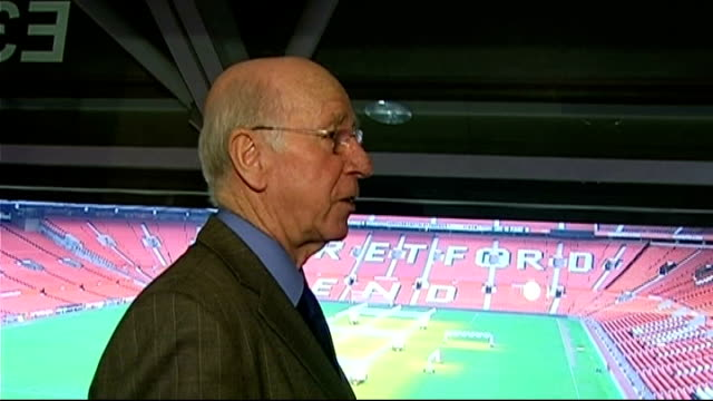 Sir Bobby Charlton interview package ENGLAND Manchester Old Trafford INT Sir Bobby Charlton surveys Old Trafford stadium and pitch Charlton interview...