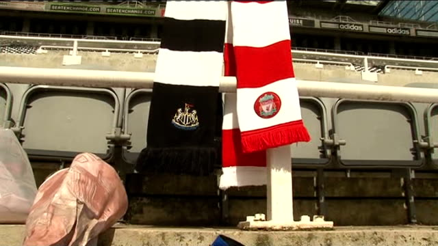 sir bobby robson dies from cancer aged 76: fans pay tribute in newcastle; fans in newcastle strips looking at tributes on ground / close up of... - football strip stock videos & royalty-free footage