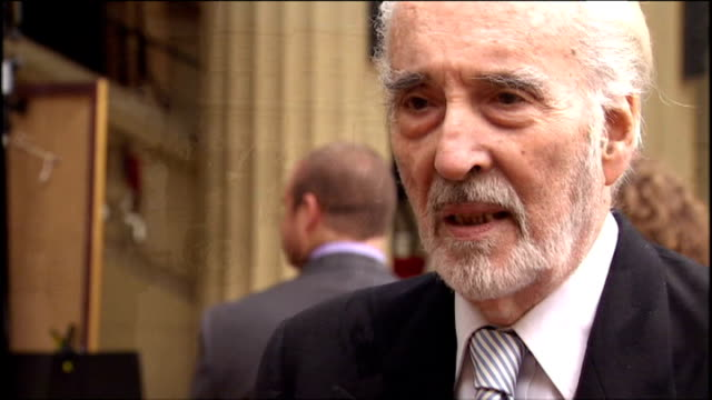sir christopher lee after being knighted for services to drama and charity, and posing for photos outside buckingham palace. - christopher lee actor stock videos & royalty-free footage