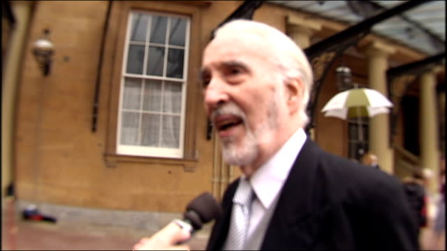 sir christopher lee speaking to reporters outside buckingham palace after being knighted for services to drama and charity. - christopher lee actor stock videos & royalty-free footage
