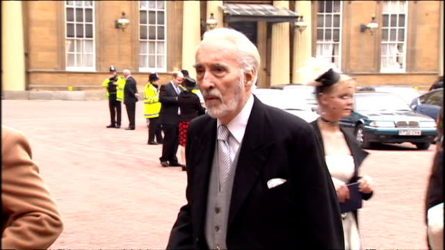 sir christopher lee with wife birgit kroencke after being knighted for services to drama and charity, and posing for photos outside buckingham palace. - christopher lee actor stock videos & royalty-free footage