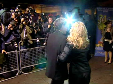 sir cliff richard and blonde woman is photographed and interviewed when arriving for the premiere of monty python's spamalot at the palace theatre,... - monty python stock videos & royalty-free footage