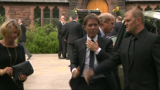 sir cliff richard critical of bbc and police over sex abuse claims lib singer sir cliff richard arriving at funeral of cilla black - cliff richard stock videos and b-roll footage