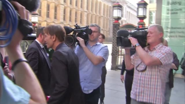 BBC reporter gives evidence ENGLAND London EXT Singer Sir Cliff Richard from court building Dan Johnson from court Dan Johnson along street TRACK