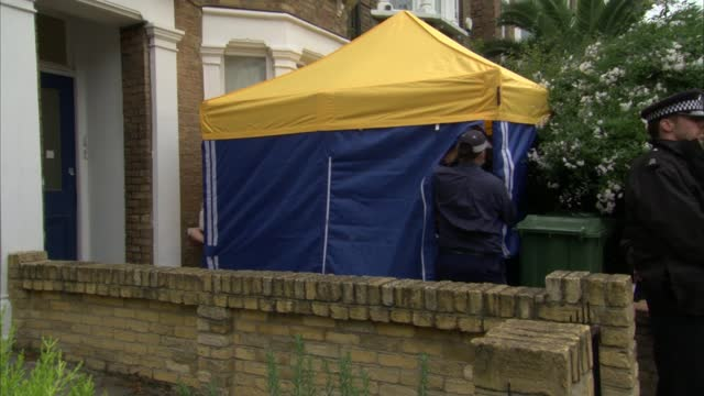 sir david amess murder: cctv shows man believed to be suspect in killing; england: london: kentish town: ext police putting up yellow tent outside... - itv lunchtime news stock videos & royalty-free footage