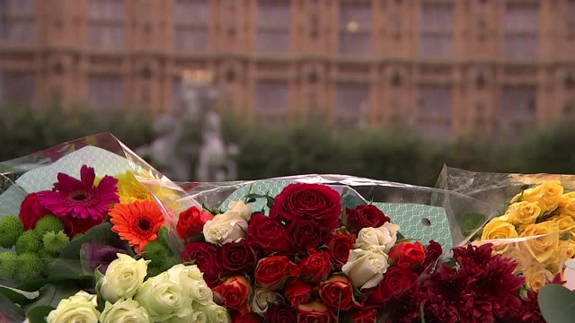 sir david amess murder: mps pay tribute; england: london: westminster: houses of parliament: ext close shot floral tributes - itv lunchtime news stock videos & royalty-free footage