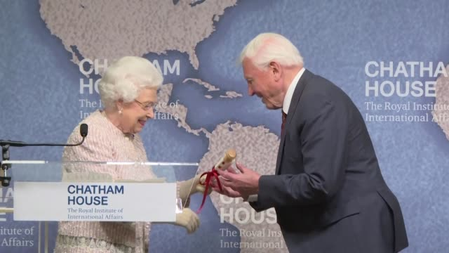 sir david attenborough and julian hector head of bbc studios natural history unit receive the 2019 chatham house prize presented by queen elizabeth... - plastic stock videos & royalty-free footage