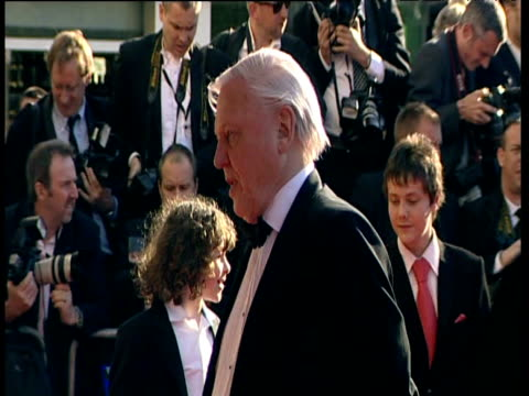 sir david attenborough poses for photographers on red carpet of british academy television awards london 26 april 2009 - television awards stock videos & royalty-free footage