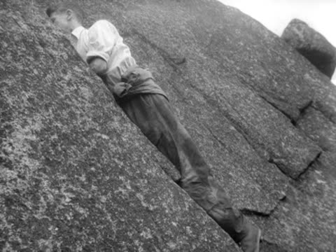 sir edmund hillary and sir john hunt climb a rockface in the lake district. - felswand stock-videos und b-roll-filmmaterial