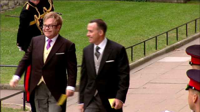 vídeos de stock, filmes e b-roll de sir elton john and his partner david furnish arrive at westminster abbey for the royal wedding of prince william to catherine middleton available in... - papel em casamento