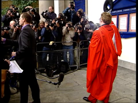Sir Elton John Music Academy Award ENGLAND London MSs Singer Sir Elton John posing for photocall in gown holding honorary doctorate from the Royal...