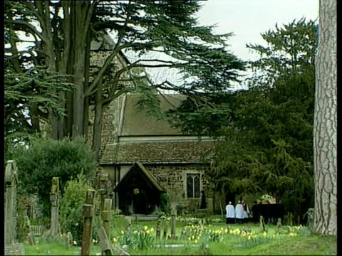 sir harry secombe funeral; church as v/o singing heard sot main window of church with tree in f/g lms mourners along out of church - harry secombe stock videos & royalty-free footage