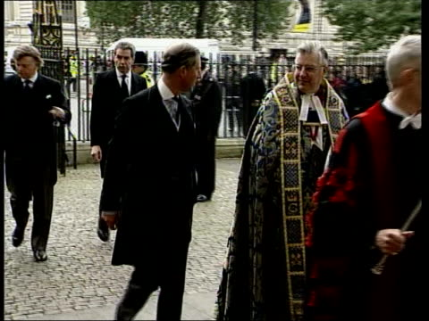 sir harry secombe memorial service; itn england: london: westminster abbey: ext prince charles, the prince of wales along past into abbey as arriving... - harry secombe stock videos & royalty-free footage