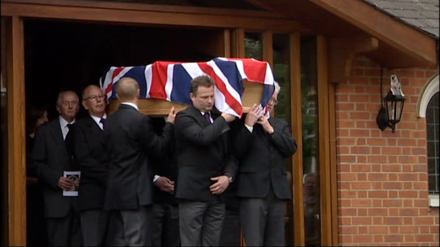 kent tonbridge corpus christi catholic church ext pallbearers carrying flagdraped coffin of henry cooper out of church to applause gv church and... - jimmy tarbuck stock videos & royalty-free footage