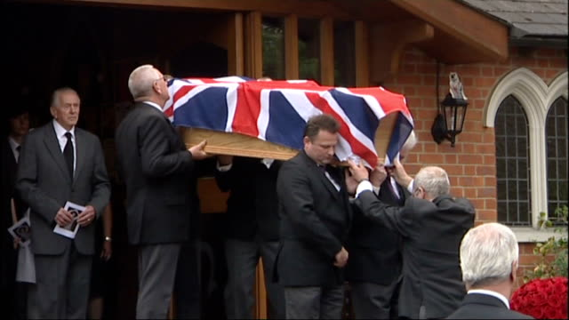 sir henry cooper funeral; england: kent: tonbridge: ext clergy leaving church / flag-draped coffin of sir henry cooper carried by pallbearers out of... - terry wogan stock-videos und b-roll-filmmaterial