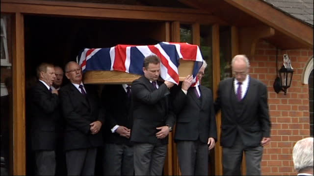kent tonbridge ext large floral boxing glove in hearse along with coffin at funeral of boxer henry cooper henry cooper coffin carried from church... - pat jennings stock videos and b-roll footage