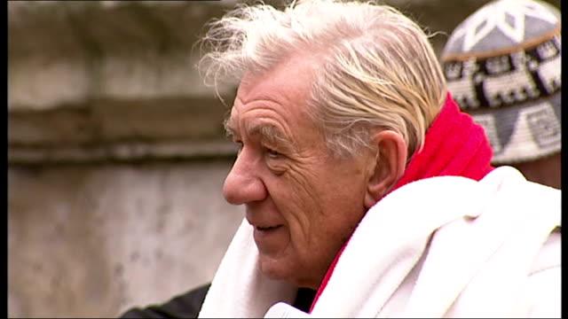 Sir Ian McKellen interview on Guillemots music video appearance ENGLAND London Spitalfields EXT Sir Ian Mckellen talking with members of pop group...