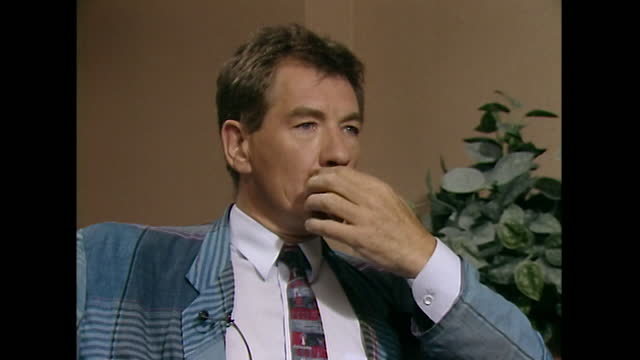 sir ian mckellen strokes his moustache contemplatively as he listens to a question during a television interview in 1989. - part of a series stock videos & royalty-free footage