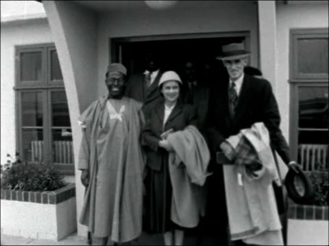 Sir J Rankin Governor General Western Nigeria arrives at London Airport ENGLAND London London Airport EXT 4shot gruap on steps of airport building /...
