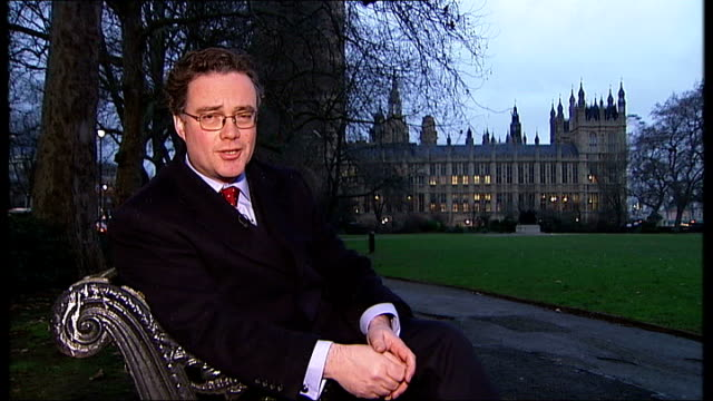 sir james crosby resigns over banking row london westminster reporter to camera - channel 4 news stock videos & royalty-free footage
