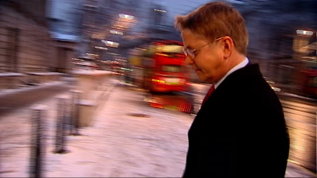sir jeremy heywood criticised over 'plebgate' investigation; england: london: millbank: ext / early morning / snow sir jeremy heywood out of car and... - jeremy heywood stock videos & royalty-free footage