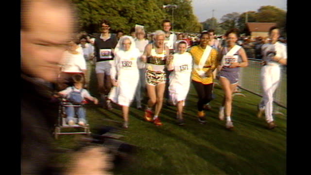 sir jimmy savile dies; 138743 / tx 28.9.1986 england: london: hyde park: ext jimmy savile taking part in fun-run with group of nuns - running shorts stock videos & royalty-free footage