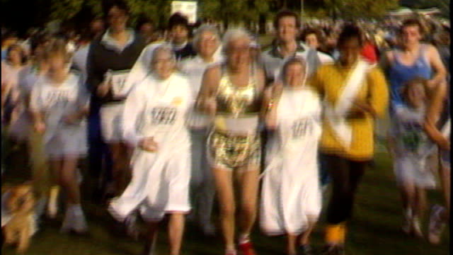 sir jimmy savile dies tx 2891986 ext jimmy savile taking part in funrun with group of nuns - ジミー サヴィル点の映像素材/bロール