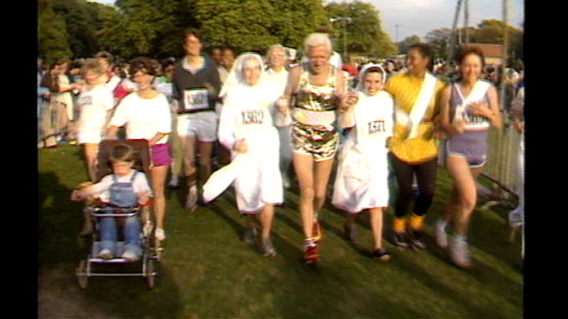 sir jimmy savile sex abuse allegations: bbc to hold internal inquiry; 138743 / tx 28.9.1986 hyde park: ext jimmy savile taking part in fun-run with... - running shorts stock videos & royalty-free footage