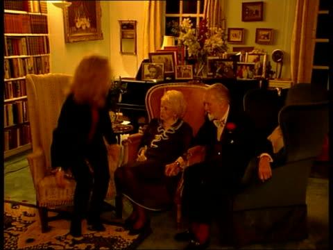 vídeos de stock e filmes b-roll de sir john mills renews wedding vows itn buckinghamshire denham sir john mills wife lady mary mills sitting in living room with daughter hayley mills... - votos matrimoniais