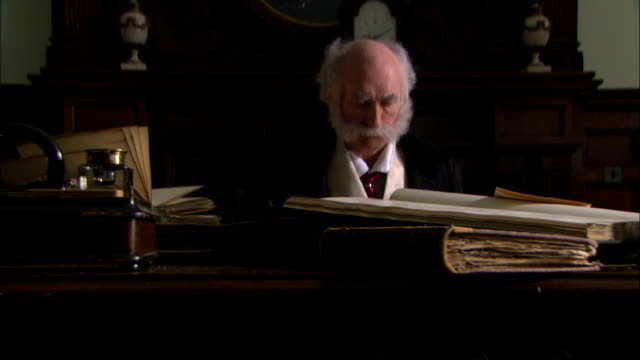 sir joseph bazalgette sits behind a desk looking at blueprints and maps during a reenactment. - historical reenactment stock videos & royalty-free footage