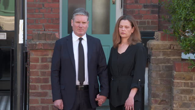 """sir keir starmer, labour leader, and wife victoria, observe minute's silence in tribute to prince philip, on day of his funeral - """"bbc news"""" stock-videos und b-roll-filmmaterial"""