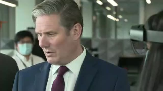sir keir starmer visits airbus uk; wales: broughton: airbus uk:, int various shots keir starmer mp speaking to people at exhibition of advanced... - cyberspace stock videos & royalty-free footage