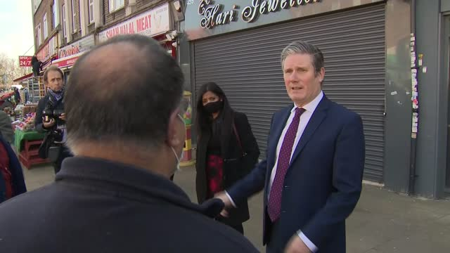 sir keir starmer visits brent; england: london: brent: ext sir keir starmer mp elbow bumps some people / wide of starmer speaking with some business... - home finances stock videos & royalty-free footage