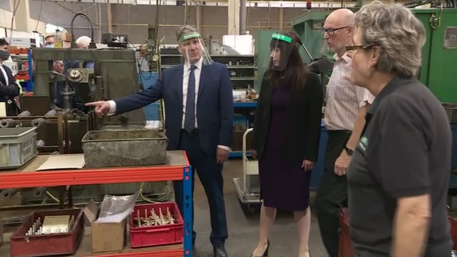 sir keir starmer visits factory in harlow; england: essex: harlow: beard and fitch factory: int gv employee explaining to sir keir starmer mp how... - pulling stock videos & royalty-free footage
