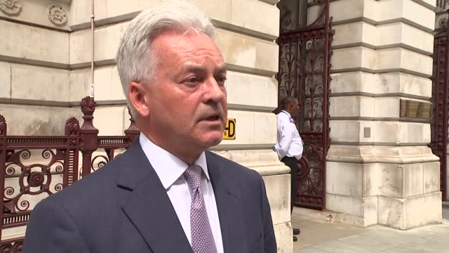 alan duncan reaction england london whitehall sir alan duncan mp interview sot england london whitehall sir alan duncan walking shot - alan duncan stock-videos und b-roll-filmmaterial