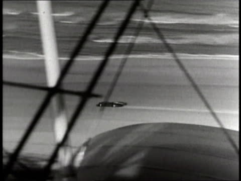 sir malcolm campbell breaks the land speed record driving the bluebird car on daytona beach. - anno 1935 video stock e b–roll