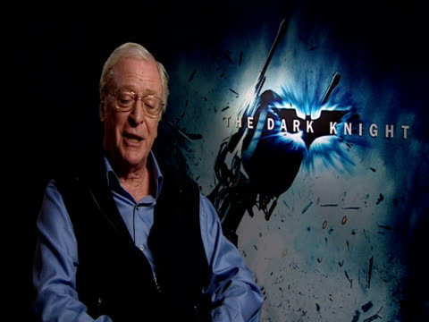 sir michael caine on how incredible heath ledger was as an actor and his portrayal of the joker and how christian bale is the best actor to ever play... - heath ledger stock videos & royalty-free footage
