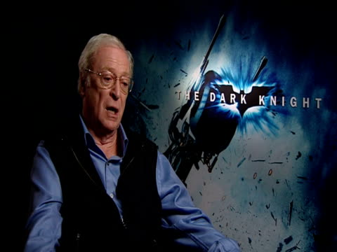 sir michael caine on seeing the film in imax and how stunning it is in that format. at the the dark knight european junket at london . - 俳優 マイケル・ケイン点の映像素材/bロール