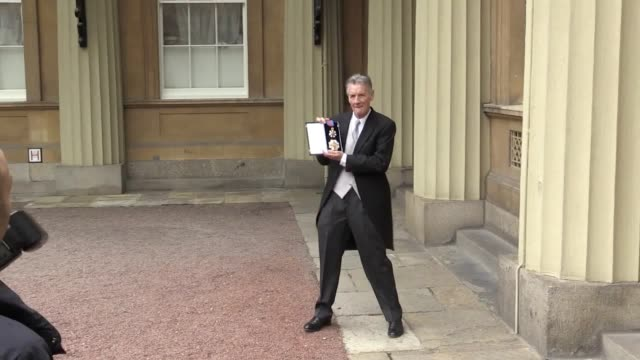 sir michael palin collects his knighthood at buckingham palace. the actor and explorer collected a knighthood on the 50th anniversary year of monty... - モンティ・パイソン点の映像素材/bロール