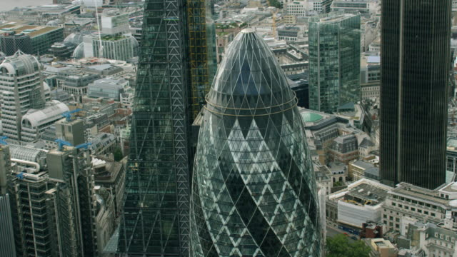 ws aerial pov sir norman foster building in city / london, england, united kingdom - famous place stock videos & royalty-free footage