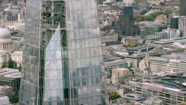 ws aerial pov sir norman foster building, st paul's cathedral and thames river in city / london, england, united kingdom - river thames stock videos & royalty-free footage