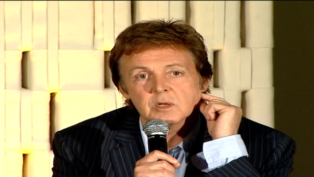 sir paul mccartney talks about his latest album kensington high street general view of mccartney on stage with unidentified man mccartney press... - paul mccartney stock videos and b-roll footage