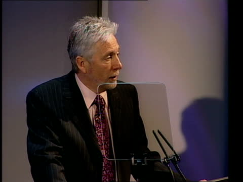 Sir Peter Bonfield sitting with other BT executives TMS Man in audience asking question with microphone TGV Stage as Bonfield along to podium Sir...