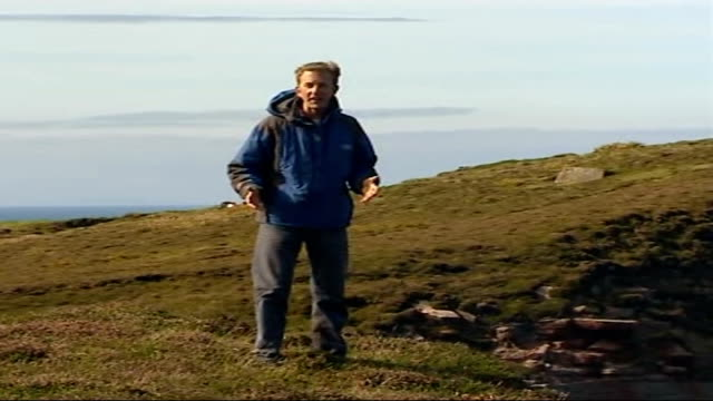 sir ranulph fiennes training for eiger climb; scotland: orkney: ext reporter to camera pull out to old man of hoy beside - hoy stock videos & royalty-free footage