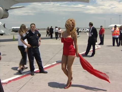 sir richard branson and pamela anderson meet the press the tarmac at jfk airport following wing walk to promote virgin atlantic's 21st anniversary... - kennedy airport stock videos & royalty-free footage