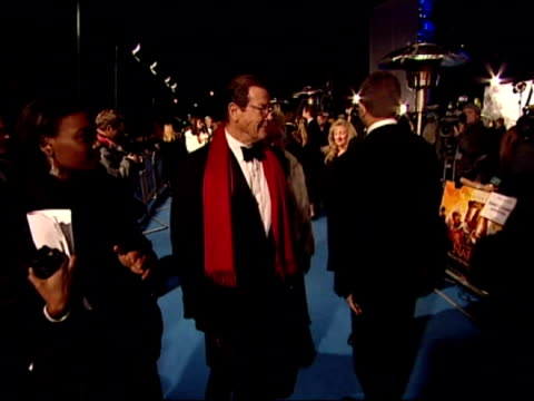 sir roger moore and his wife, kristina, arrive at the narnia royal premiere at the royal albert hall in london - royal albert hall stock videos & royalty-free footage